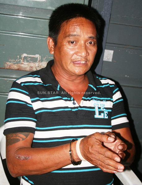 "MANILA. Robert ""Obet"" Ponce, a suspect in the murder of Ruby Rose Barrameda, was arrested by the National Bureau of Investigation in Cauayan, Isabela, Thursday afternoon. (Michael Superales/Sunnex)"