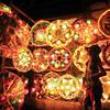 STAR TURN.  An early display of Christmas lanterns in Barangay Basak Pardo, Cebu City attracts a child.  (Sun.Star Photo/Alex Badayos)