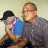 "FOTO 5 - Jachob Rasumman (with covered face) and his lawyer  Atty. Michael Florentino ""Jong"" Dumlao. inside National Bureay of Investigation (NBI-10) office in Cagayan de Oro (PHOTO BY JOEY P. NACALABAN)"