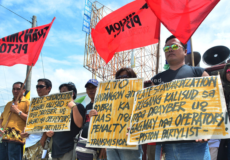 DAVAO. Jeepney operators and drivers picket in front of the Land Transportation Office to oppose the implementation of plate standardization on Monday. The law is an additional burden, they said. (Seth delos Santos)