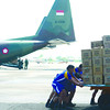 Members of the military help unload relief goods from three C-130 planes from Indonesia that landed at the Mactan Benito Ebuen Air Base on Thursday morning, Nov. 14, 2013. Last Saturday, the Asean neighbor also sent two C-130 planes carrying assistance for victims of Typhoon Yolanda. (Alex Badayos photo/Sun.Star Cebu)