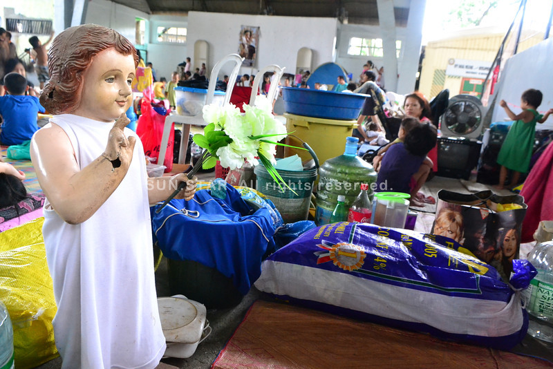 Evacuees never failed to bring statues of saints at the covered court of Barangay Macasandig, which is one of the 30 identified evacuation centers of Cagayan de Oro City. (Lenesse Marie Libres photo)