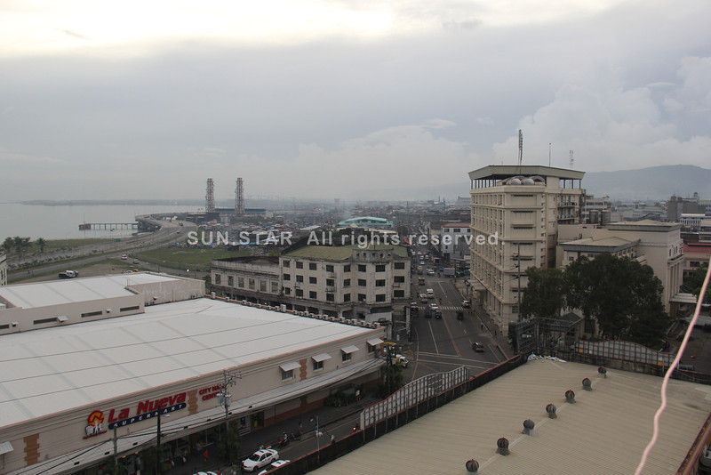 CEBU CITY. A view of the M.C. Briones Street from atop the Metropolitan Cebu Water District ( MCWD) located at Magallanes Street, this city, around 5 p.m. Thursday. A calm afternoon before Super Typhoon Yolanda brings rains over the province. (Jay Ann Clamohoy/Sunnex)