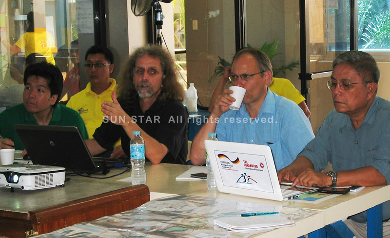 Martin Krejza, business manager of Sindlar Group (second left), presents to the city disaster risk reduction management council headed by Mario Verner Monsanto (right) and other stakeholders the project that could monitor flood threats in Cagayan de Oro City. (Anjo J. Bacarisas)