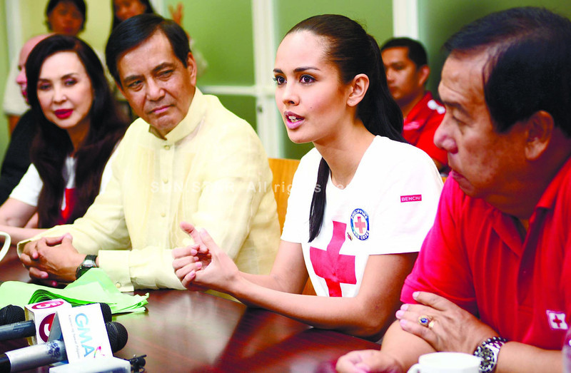 Miss World 2013 Megan Young (second from right) addresses a press conference on her work and that of the Philippine National Red Cross to ease the suffering of typhoon Yolanda's survivors. (Allan Cuizon)
