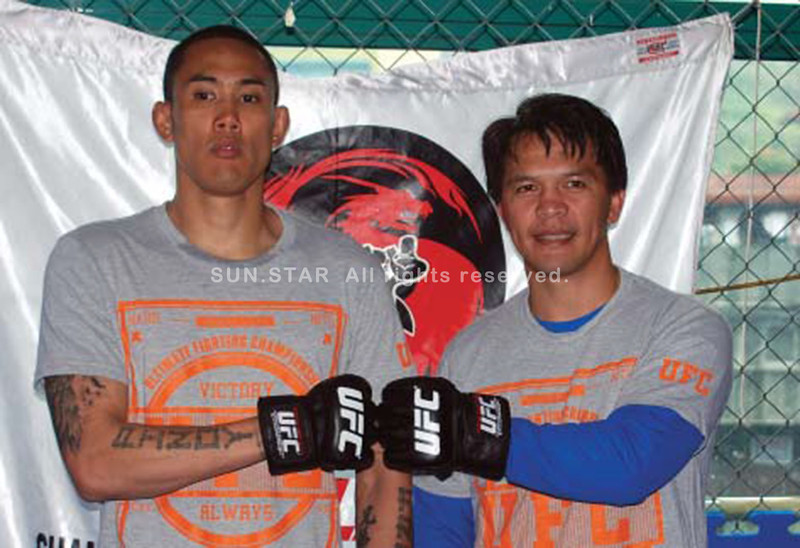 BAGUIO. Team Lakay's Dave Galera fistbumps with coach Mark Sangiao after their announcement of their UFC stint in Singapore next year. Galera is the first Filipino mix martial arts figther to be signed in the largest MMA promotions in the world. (Roderick Osis)