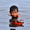 Kid swimming, playing