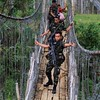 Soldiers crossing a hanging bridge