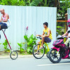 A man turns an ordinary bicycle into a work of wonder—he makes people wonder how he is able to mount the four-wheel contraption. (Ruel Rosello/Sun.Star Cebu)