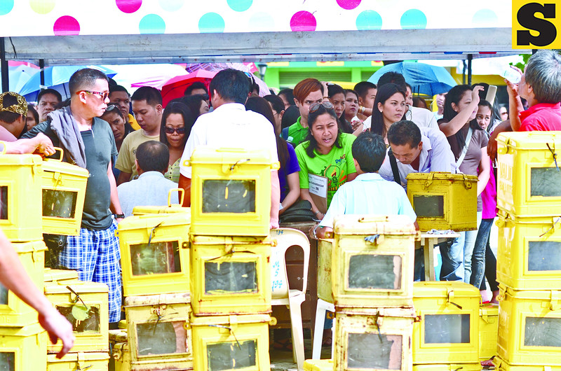 Teachers lining up ballot boxes for barangay elections