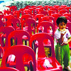 A child enjoys his snack in peace, after a crowd leaves at the end of the State of the Children report delivered by Mandaue City Mayor Jonas Cortes. (Allan Cuizon/Sun.Star Cebu)