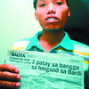 MISTAKEN. Reynaldo Patiño shows the news story printed in Sun.Star SuperBalita that says he died in a road accident in Barili. (Alex Badayos)