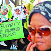 "DAVAO. Young girls in hijabs along with their mothers join the ""Davao, Duyog sa Kalinaw"" rally for peace, a parallel activity with the signing of the Government of the Philippines-Moro Islamic Liberation Front Framework Agreement on the Bangsamoro at the Freedom Park Monday. (King Rodriguez)"