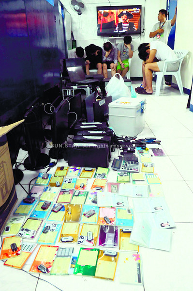 GAMBLING STYLE.  Six South Koreans wait for the next move from the Regional Special Operations Group after being arrested in Camputhaw, Cebu City for allegedly running an online betting operation.  (Sun.Star Photo/Allan Defensor)