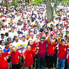 WAKEE WAKEE EH EH.  Some 2,000 to 3,000 by police estimate accompany boxing promoter Wakee Salud (in red shirt with dark shades) the Commission on Elections to file  a certificate of candidacy for Cordova mayor. Salud has been declared by the court to be a non-resident of Cordova. Salud has come up with a complete slate, who are identified by their red shirts.  (Sun.Star/Alan Tangcawan)