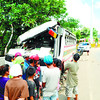 ACCIDENT-PRONE. The morning after the accident, a crowd gathers near the Jegans bus that hit a gate and wall in Barangay Don Andres Soriano, Toledo City. The accident site lies at the foot of a slope, where the bus suddenly lost its brakes. (Allan Defensor)
