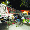 WRECKED. A Jegan's bus lies on its side after hitting a wall in Barangay Don Andres Soriano in Toledo City. In the same area two years ago, 15 people died when another bus also swerved out of control and hit a wall. (Sun.Star Photo/Alex Badayos)