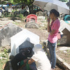 CAGAYAN DE ORO. Residents take time out to visit and clean the grave of their departed loved ones ahead of the annual commemoration of All Souls' Day on November 2. (Joey P. Nacalaban)