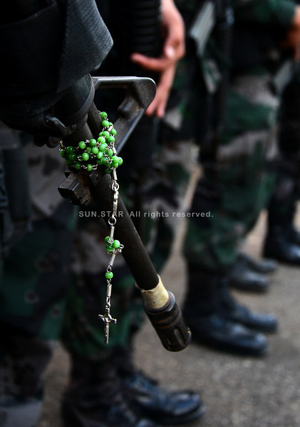 Gun and rosary