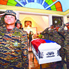 CEBU. Colleagues in Cebu flank the coffin of Naval Forces Petty Officer 3 Jose Audrey Banares, a father and husband who died during an encounter between soldiers and the Moro National Liberation Front. He is a survived by his wife of 17 months and their baby, who will turn three months old soon. (Alex Badayos)