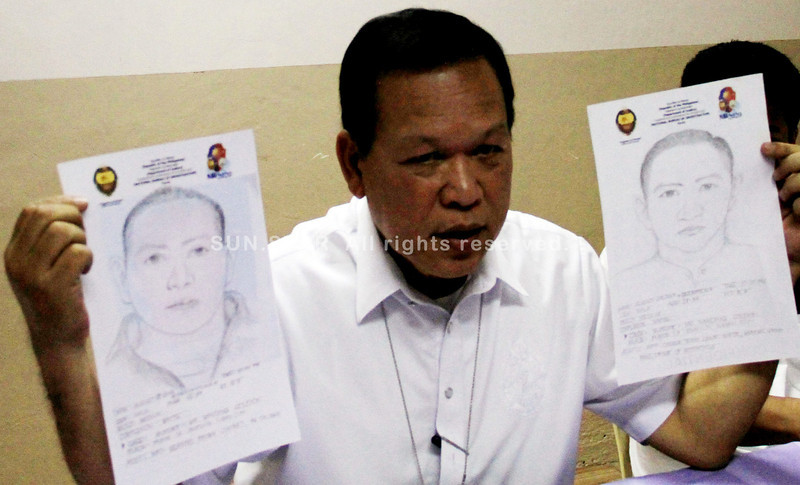 """NBI-Northern Mindanao regional director Ricardo A. Diaz presented to the media the facial sketches of the two suspects involved in Fernando """"Nanding"""" Solijon's slay in a press conference on September 2. (Richel Umel photo)"""