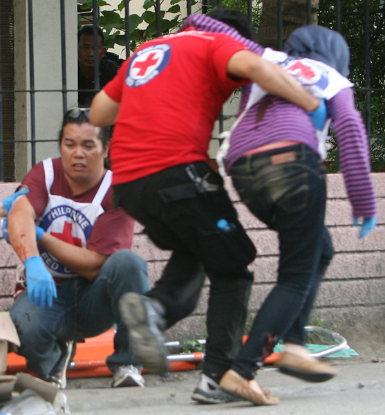 ZAMBOANGA. Three Red Cross volunteers were among the 11 people injured Friday afternoon when an M-203 grenade coming from the rebels' position landed on their side. (Bong Garcia)