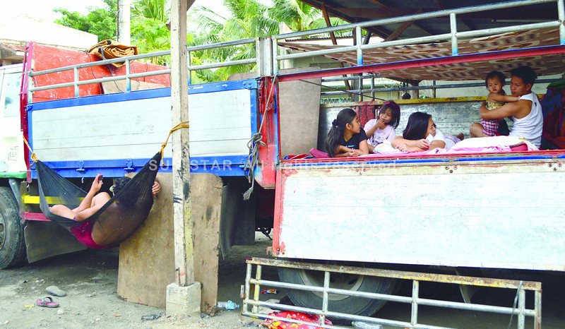 CEBU. This 10-wheeler flatbed brought 60 people, with 30 young children among them, all the way from Barangay Talon-Talon in Zamboanga City to an address in Tres de Abril in Cebu City where relatives of the evacuees live. The land travel took 33 hours. (Alan Tangcawan)