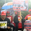 MEMBERS of Bangon Kagay-an Inc. and Save CDO Now Movement show off their disgust to Cagayan de Oro Mayor Vicente Emano through placards as they trooped to the regional office of the Department of Interior and Local Government (DILG) Monday afternoon to witness the first day of the supposed marathon hearing of the cases filed against Emano. (Joey P. Nacalaban)