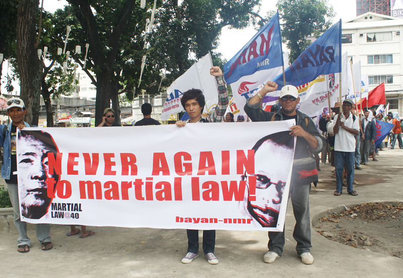 MEMBERS of militant groups march through the streets of Cagayan de Oro on Friday to call for an end to human rights violations and other political issues as they commemorate the 40th anniversary of Martial Law. (Joey P. Nacalaban)