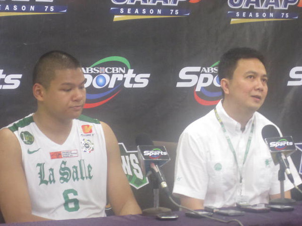 Bigman Norbert Torres (left) and coach Gee Abanilla face reporters after La Salle earned the last semifinal ticket in the 75th UAAP men's basketball tournament. (Virgil Lopez/Sunnex)