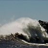 "B grade set subject / Water........"" Wild"" by Jacqui Scott........ACCEPTED.<br /> <br />  Greymouth tiphead on a wild day if I'm not mistaken. Person on the Cobden tiphead is not sharp which makes me think you've cropped in a bit or perhaps he/she was moving. The middle of the wave is burnt out but it's a difficult shot for the middle of the day. You need to crop out some of the sky but lots of drama in the breaking wave... ACCEPTED."