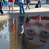 "B grade open........ ""Tourist""  by Jacqui Scott........Accepted.<br /> <br /> Tourist<br /> This is an interesting composition with great reflections but I kept struggling with the fact that the torsos and heads of all of the subjects are cut off in the top of the frame and are only visible in the reflections. Now some judges may be quite happy with this but I found it a bit disconcerting. A clever idea and obviously some thought put into it, but, on reflection, (Duh), 1 think I'd prefer to see more of the people in the top of the frame. Accepted."