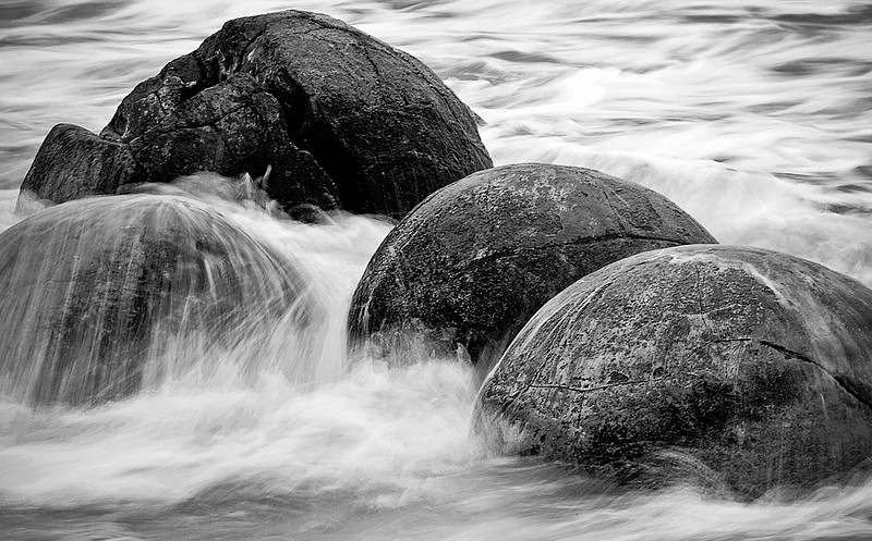 "B grade Open........""Awash"" by Andy Woods........Honours<br /> <br /> An excellent well composed and well exposed shot of the Moraki Boulders. Note how the foreground boulders lead into the darker background boulder. I like the f22 plus aperture treatment which gives the water that blur which highlights the impression of motion but the shutter speed is slightly to slow which has let you down here slightly as some of the water detail is burnt out. If you had photoshop tweaking the red/green sliders when you converted to Black and White might have helped here plus of course the dodge and burn tools. Excellent effort Honours."
