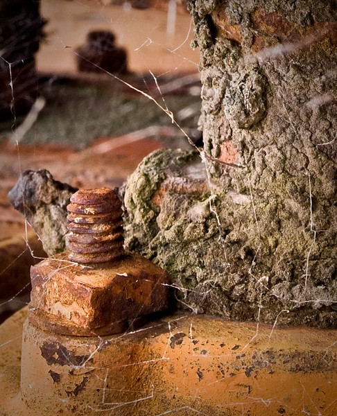 "A grade open........"" Still Secure "" by Del Tubb........Accepted<br /> <br />  Accepted.  I like the bolt and nut but the composition could be tighter, zoom in on the subject, the cobwebs and the busy encrustation is a bit distracting."