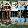 """B grade open........"""" Palafito's (Stilt Houses ) Chile  by Anne Macdonald........Accepted.<br /> <br />  This is a great example of a good title. It tells you the place and puts it all in context Clearly shot in the middle of the day and would have been stunning with either morning or evening light (depending on orientation relative to the sun]. But who cares, it's a nice colourful shot that tells a story. An inhabitant hanging out over the veranda or hanging up washing would have added extra or a boat tied up by the ladder but you can't control what's there unless you're willing to go back time and time again. A nice shot that's a step beyond a tourist snap. Merit"""