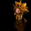 """A grade set subject / Toys........"""" Who Me!  """"  by  Andy Woods........Merit.<br /> <br />  Nearly a perfect shot, well lit, sharp and well composed.... Except for the fact that a smidgen of hair has been cut off the top. Accordingly a merit"""