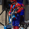 "Novice grade set subject / Music........"" Spider Man Playing His Guitar ""  by  Nina Henderson........Acceptance.<br /> <br /> All dressed up and ready to perform. What a shame you didn't wait until he looked up<br /> or got down lower so you could see his face. The blue and red contrasting colours<br /> certainly make it an eye catching image. I like the way you have caught his raised<br /> foot."
