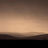 """ Dusky Hills ""  By  Valerie Pohio.<br /> <br /> I love the minimalistic approach to this subject and the recession in the hills. If you crop the darkest area off the bottom foreground then I feel the shot has even more impact. Nice work!"