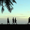 "Open subject, A grade........"" Evening Stroll In Apia ""  By  Thierry Huet........Honours.<br /> <br /> A very simple and eye catching silhouette. There is just enough palm tree showing to break down the sky and I like the way the trunk leans in to the picture. You've waited until there is nice spacing between the men and enough space for the first man to walk into. The small boat and the strip of sand provide an extra interest just below the horizon. The lovely soft colours in the sky add another dimension to this great image. The only niggle I have is the small plant in the RH corner, clone it out!!"