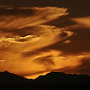 Fiery Sky Brian Dowling<br /> The cloud formations together with their colour add instant interest to this image while the dark silhouette of the mountains forms a strong solid base. The image suits the panorama format to which you have cropped it. Nicely done!<br /> Honours