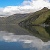 Arnold  Picard WANAKA REFLECTIONS<br /> lovely, symmetrical reflections – good exposure gives rich colours – all the action is on the right hand side, so I wonder if you'd consider cropping from the left, almost to the point of land in the centre – before you scream in anguish, try it and see how much more powerful the picture is – it's now almost a square but we don't have to stick to a single rectangular format all the time.								                                                      ACCEPTED
