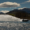 Rod Macleod JETBOAT ROOSTER TRAIL<br /> hey, well done for getting the whole boat and tail in the frame – it's a running joke here that Kay can't get an entire moving object in the one shot – on the whole, that's true, but now that I'm not wasting miles of film on every shot, I can almost get it right – a wee bit more exposure would have lifted this – for me, it's just a tad too dark throughout – the tree on the right acts as a good visual barrier to stop the eye leaving the frame.			                      ACCEPTED