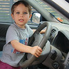 Rod Macleod YOUNG DRIVER<br /> the dominant thing in this picture is the car, not the child – soft lighting means no harsh, heavy shadows, which of course is a good thing – unfortunately, the plane of focus is not on the child, so he's rather fuzzy – good skin tones and his eyes are to die for! – by B Grade I expect more, particularly control of your focus.				                                   NOT ACCEPTED