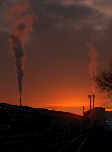 "Factory discharge.Allan Ford A<br /> Tells the story of man belching its waste into the atmosphere, made all the more poignant by the fact that it is at sunrise or sunset when our planet is at its most beautiful.  Composition is very simple and does not do anything to tell us about the ""style"" the photographer may use to tell the story.  Well exposed, good story told in a very straightforward manner. Accepted"