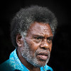 Allen Hogan STALL HOLDER AT THE MARKET PORT VILA <br />  A superb portrait but there's nothing to indicate he's a stall holder – a wee crop from the top to bring the eyes above the horizontal centreline would make this appear more balanced – terrific lighting – terrific angles – terrific skin tones but where's the terrific stall!? – in other words, watch what you are saying in the title.<br />  MERIT