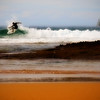 """Amy Ballantyne SUNDAY SURF<br /> unless you've created a digital pinhole camera, you've obviously """"mucked about"""" with this image and I like the effect - lovely straight layers of differing colours and textures, broken only by the boat, the gull and the surfer – an aside: I wish the surfer was moving into the picture rather than out of it – I'd actually clone out the boat, it's not necessary because the surfer and the gull balance each other perfectly.  HONOURS"""