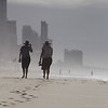 Beach Walkers Rod Macleod<br /> The figures are nicely set apart from the background by the haze. Their placement within the frame from left to right is pleasing however a crop from the bottom to remove some of the out of focus sand would bring them into a stronger place vertically within the frame. A well spotted photo opportunity.<br /> Accepted   B grade