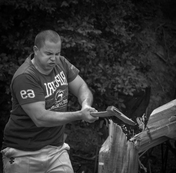 "The Axeman<br /> This image works well in monochrome although I'd give it a tad more contrast. The action combined with his expression add power to the image. There are two ""if only's"" for me regarding this image; the axeman had his eyes open, and you hadn't flipped the image so all the writing on his shirt is back to front.<br /> Not Accepted 001 A grade"
