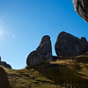 At Castle Hill  -  Rob Norman<br /> I like the fact that the author has taken this image from a low vantage point – the rocks appear large and imposing, providing a sense of grandeur.<br /> Despite the fact that the photo is taken looking into the sun, there is still sufficient detail in the shadowed side of the rocks.<br /> I can appreciate the temptation to include the burst of sunlight on the left of the image – it does add extra interest. However, with the decision to include this, compositionally we are left with a large amount of sky which does tend to separate the rocks within the shot.<br /> As a viewer my attention is then divided between the sunburst rock on the left and the other groupings on the right. Notwithstanding this, the image is still of an acceptance standard. Accepted