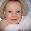 Cody Amy Ballantyne<br /> The fresh look, the soft colours and the expression really sell this image. Cody holds your attention with those beautiful eyes and the pure smile. The only changes I would suggest are a crop from the right to crop into the hat in a similar manner to the that on the left, and a crop from the bottom to remove the fingers. The only problem with cropping this much off the bottom is the placement of the eyes becomes somewhat central in the vertical, however a partial crop combined with a bit of cloning over the fingertips would keep the eyes closer to the top third.<br /> Merit